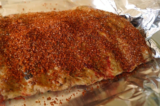 raw pork ribs covered in spice rub