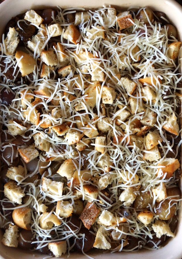 French Onion Mushroom Casserole topped with grated swiss cheese in baking dish