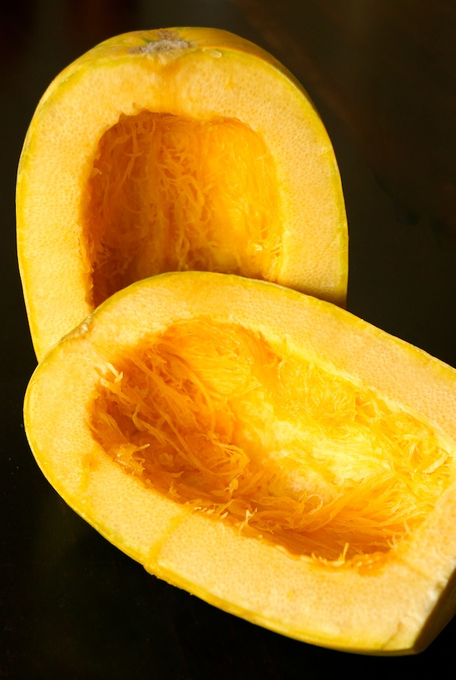 Two halves of spaghetti squash with seeds removed.