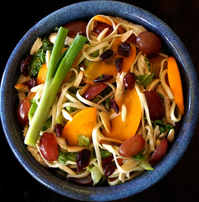 colorful with orange, purple and green - persimmon udon salad in blue ceramic bowl