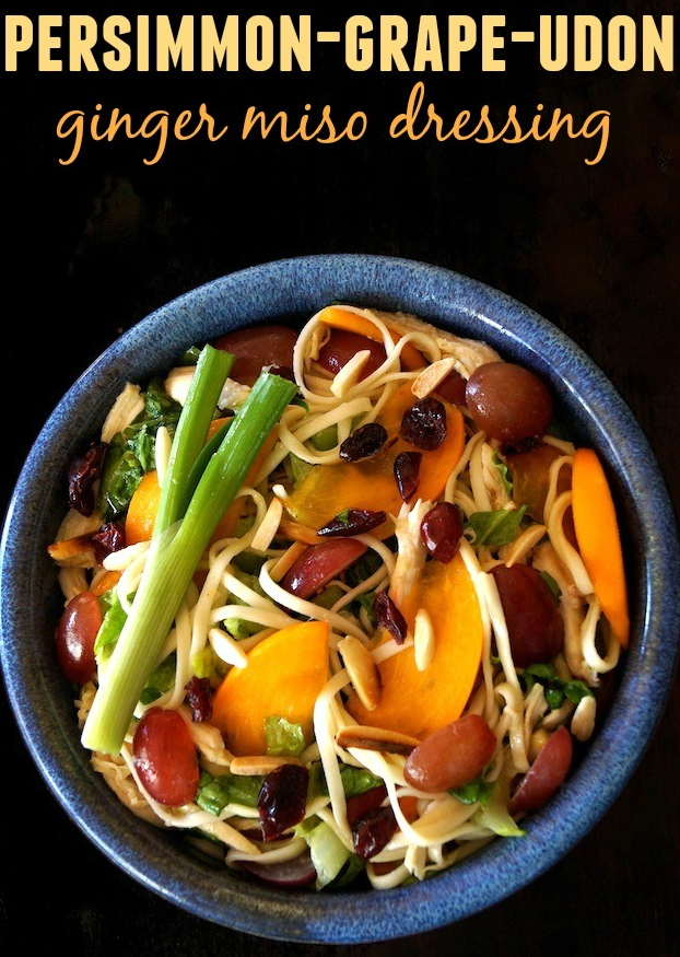 Winter Fruit Salad with Udon and Chicken with persimmon slices in a blue bowl