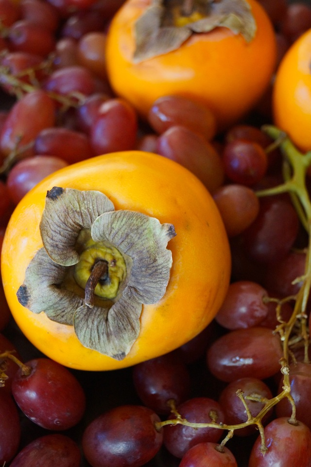 Persimmons and grapes