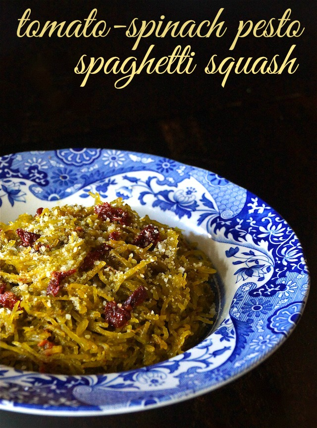 Tomato-Spinach Pesto Spaghetti Squash in a pretty blue and white shallow bowl.