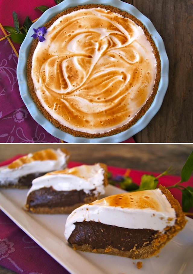 One whole Peanut Butter S'mores Merningue Pie in a light blue pie dish.