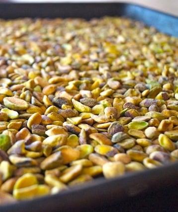 pistachios on a baking sheet