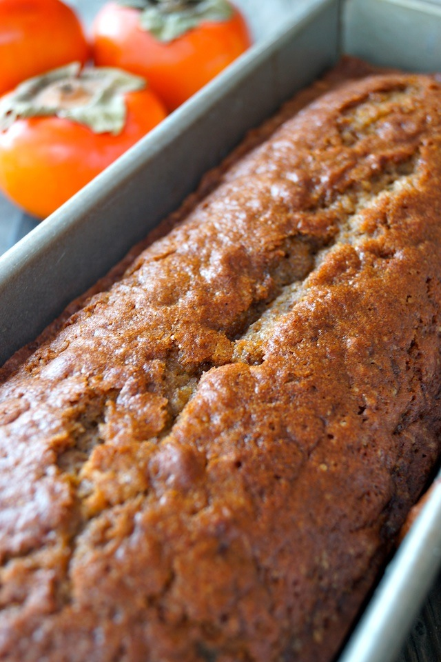 baked loaf of Persimmon Gingerbread in bread pan
