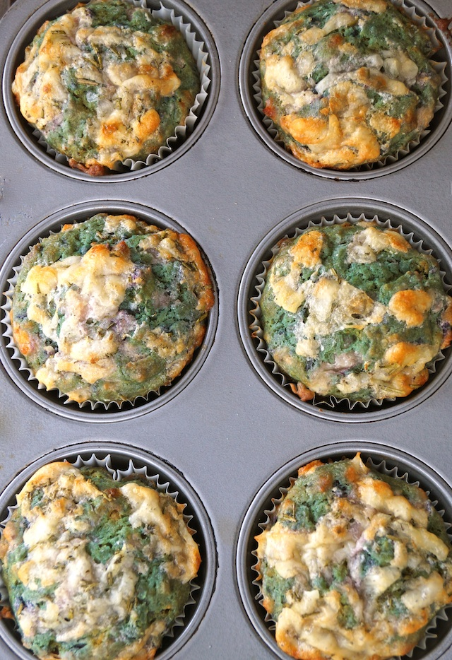 6 purple Sweet Potato Muffins still in the muffin tin, that have turned green.