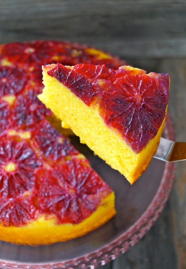 Turmeric Blood Orange Upside Down Cake with one slice removed and on a metal spatula