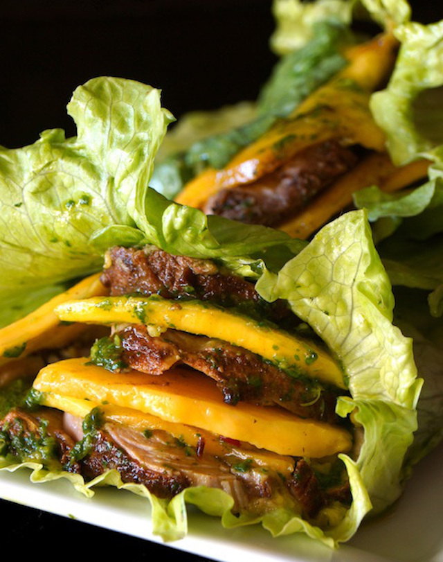 Mango Pork Lettuce Wraps with Chimichurri on white plate