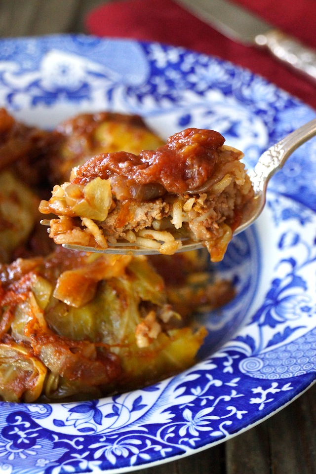 One bite of Stuffed Cabbage Recipe with Tomato on a fork