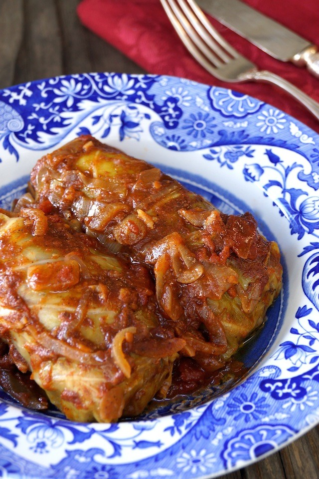 two Stuffed Cabbage rolls in a blue and white plate