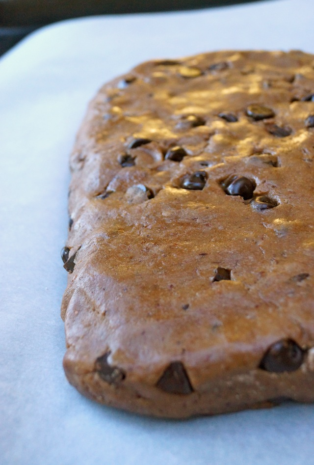 Triple Chocolate Gluten-Free Biscotti dough shaped into one large piece on parchment paper