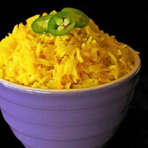 Turmeric rice in purple bowl