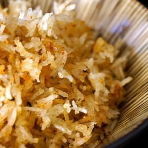 Spicy Crispy Rice in a striped beige bowl.