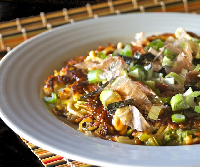 Yakisoba Omelet Okonomiyaki in a white bowl