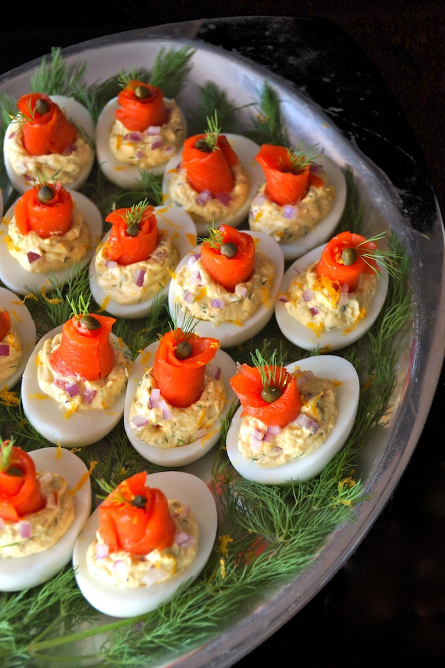 The Best Smoked Salmon Deviled Eggs with fresh dill on a silver platter