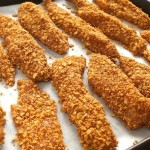 Spiced Tortilla Crusted Baked Chicken Strips Recipe with Zesty Lime Crema - With a crispy, gluten-free, spicy crust, and a refreshing, zesty sauce, these succulent chicken strips are beyond delicious!
