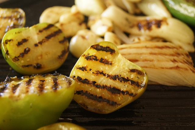 tomatillos and onions on grill with grill marks