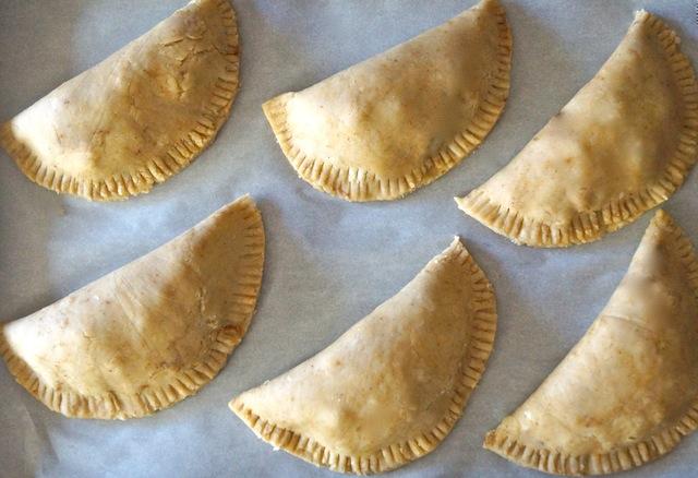 raw Chorizo-Potato Spiced Sesame Hand Pies on parchment