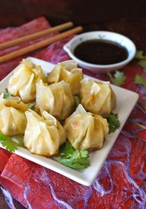 Garlic Ginger Chicken Dumpling Recipe (Momo) - Juicy chicken, flavorful vegetables and aromatic garlic and ginger in every bite! The perfect hors d'oeuvres or appetizer that you won't be able to stop eating!