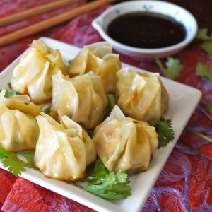 arlic-Ginger-Chicken-Dumpling-Recipe-(Momo) - Juicy chicken, flavorful vegetables and aromatic garlic and ginger in every bite! The perfect hors d'oeuvres or appetizer that you won't be able to stop eating!