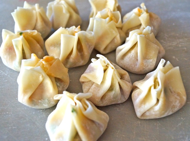 several Garlic Ginger Chicken Dumplings on parchment