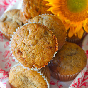 Banana Honey Muffins on a floral cloth with a sunflower
