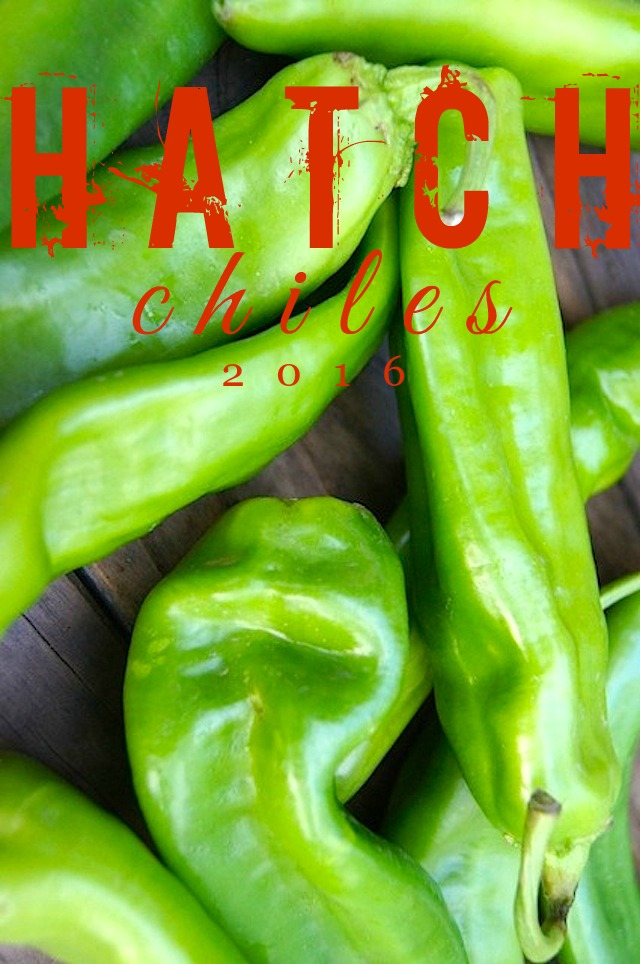 Many bright green Hatch Chiles on a wood surface with red text that says, Hatch Chiles 2016.