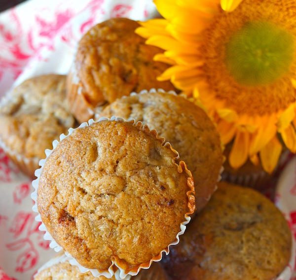 Honey spiced banana muffins with a big, pretty sunflower.