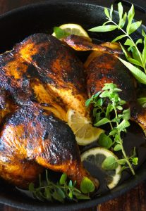 Smoky Paprika Lemon Herb Chicken Under a Brick Recipe -- Packed with fresh, smoky and tangy flavor, this is the most succulent, delicious chicken of all time!