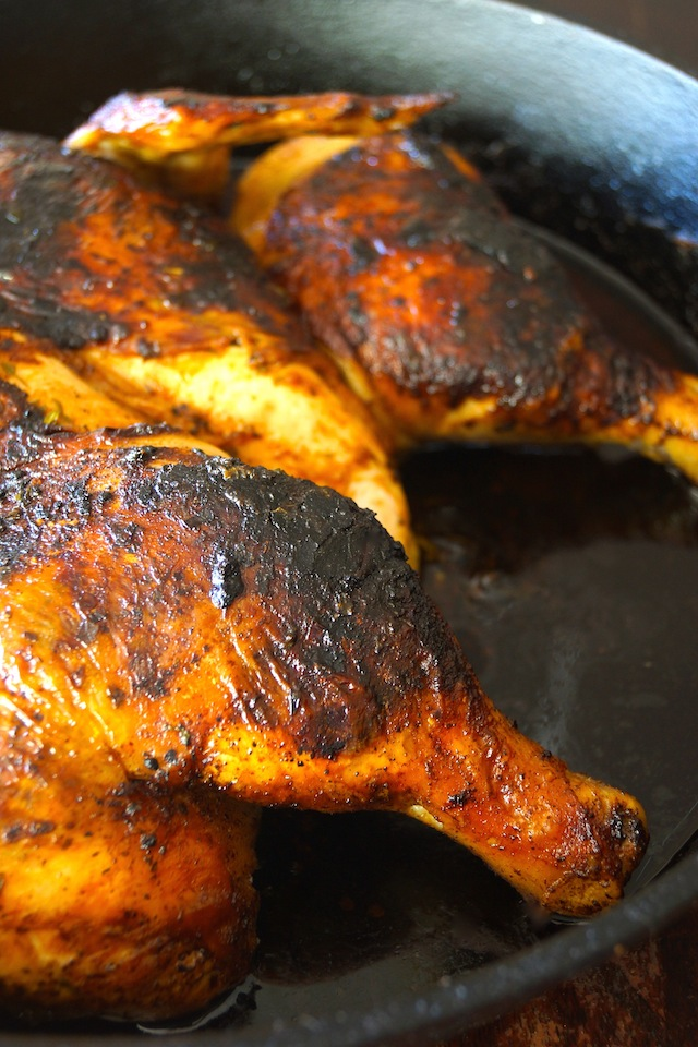 Lemon Herb Chicken Under a Brick Recipe in cast iron skillet