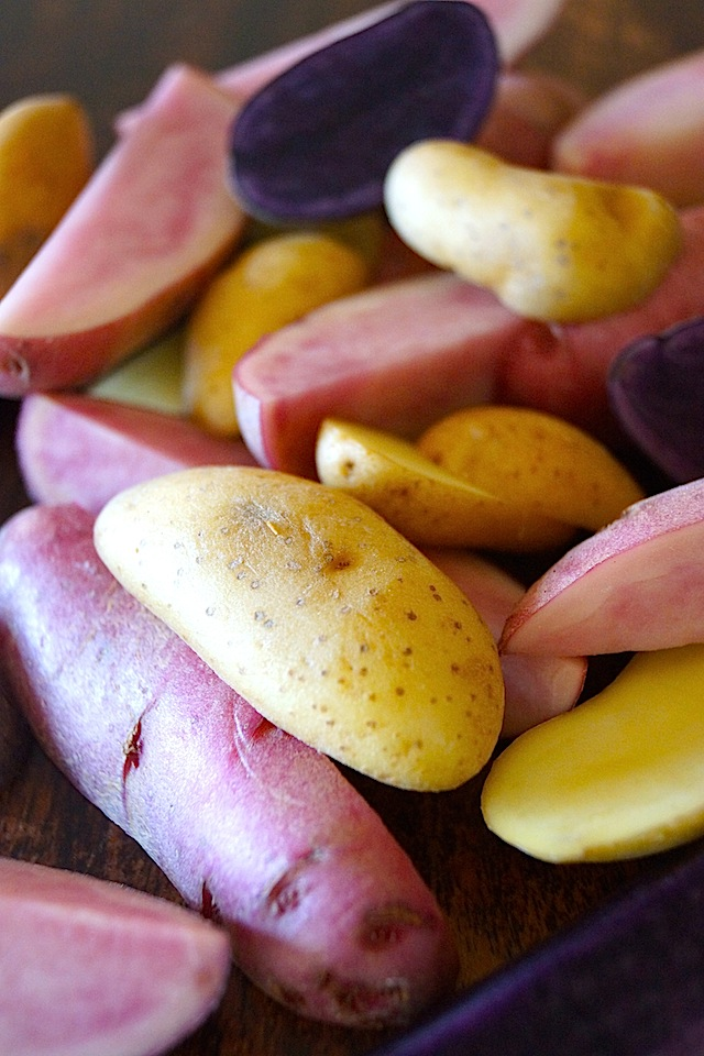 Sliced purple, yellow and pink Fingerling Potatoes.