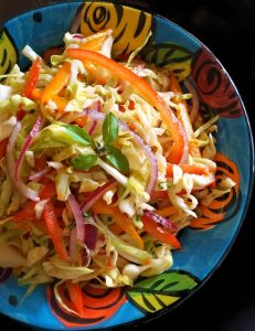 Asian-Style Basil Slaw Recipe -- This sweet and spicy coleslaw is packed with incredibly delicious, super fresh flavors! Asian-Style Basil Slaw is the perfect side for grilled meat, chicken or fish.