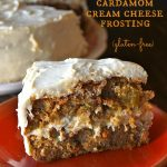 Gluten Free Spiced Carrot Cake Recipe with Cardamom Cream Cheese Frosting -- Filled with warm spices, sweet carrots and golden raisins, this is the perfect celebration cake for fall.