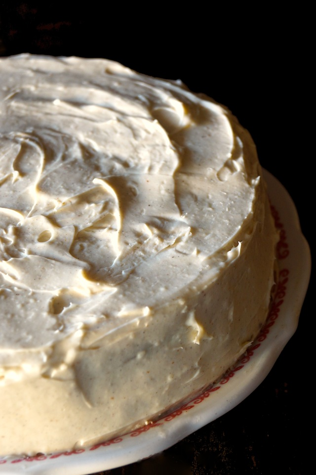 top view of a whole Gluten Free Spiced Carrot Cake Recipe with Cardamom Cream Cheese Frosting on a plate