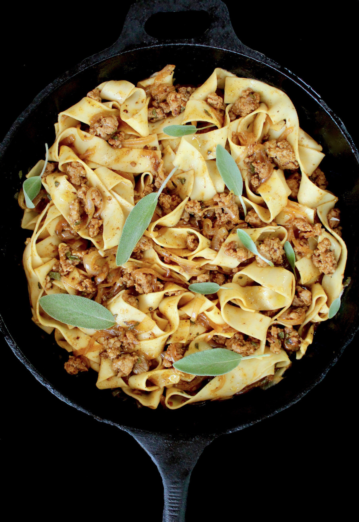 Pumpkin Pappardelle with sage and sausage in cast iron skillet