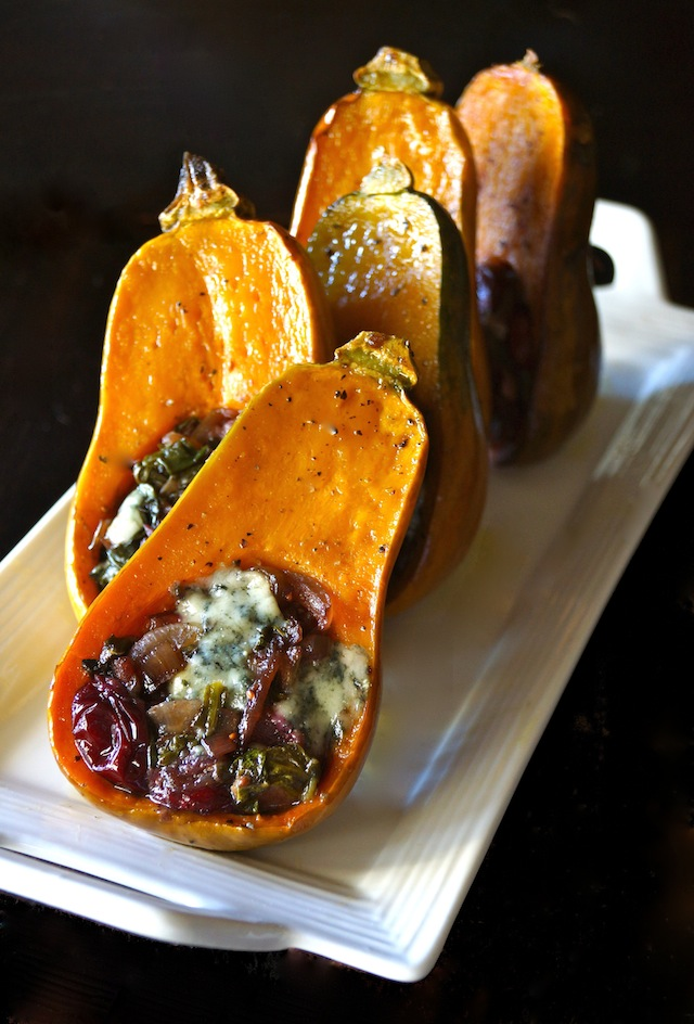Caramelized Onion-Bacon and Cranberry Honeynut Squash - the orange squash are halved and filled