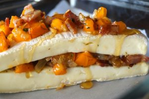Cinnamon Persimmon Bacon Baked Brie Recipe -- Cinnamon Persimmon Bacon Baked Brie is warm, smoky, sweet and over-the-top delicious! It's the perfect appetizer to get your guests ready for the Thanksgiving feast!