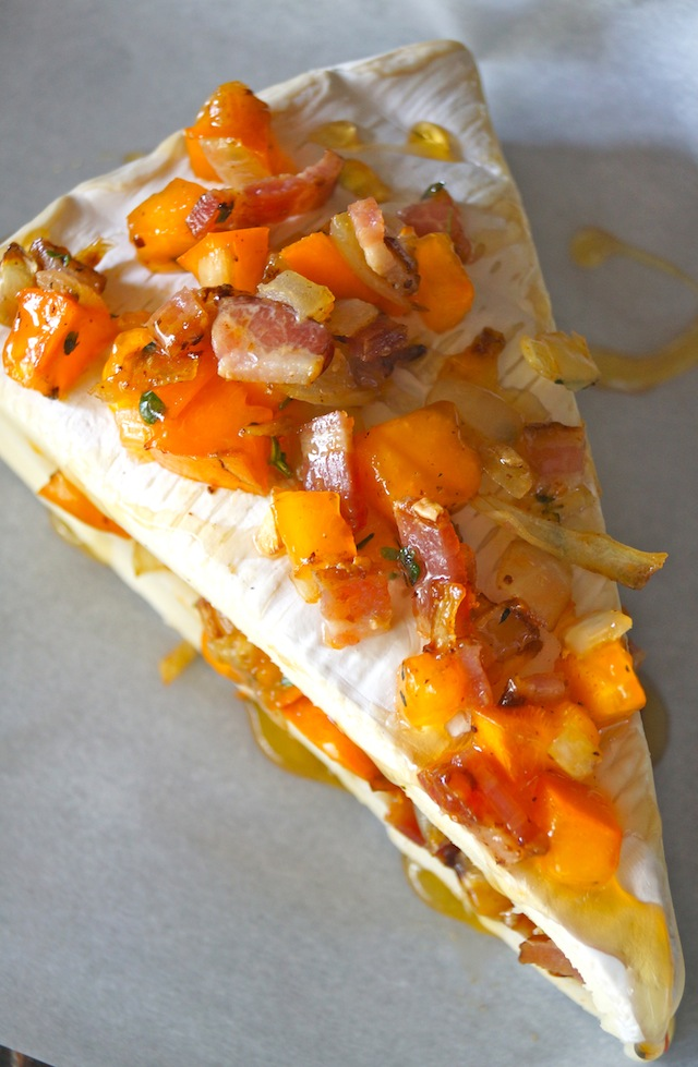 Cinnamon Persimmon Bacon diced on Brie wedge of brie, on parchment paper
