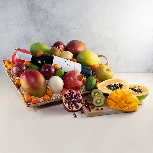 Fruit in a basket with a bottle of wine