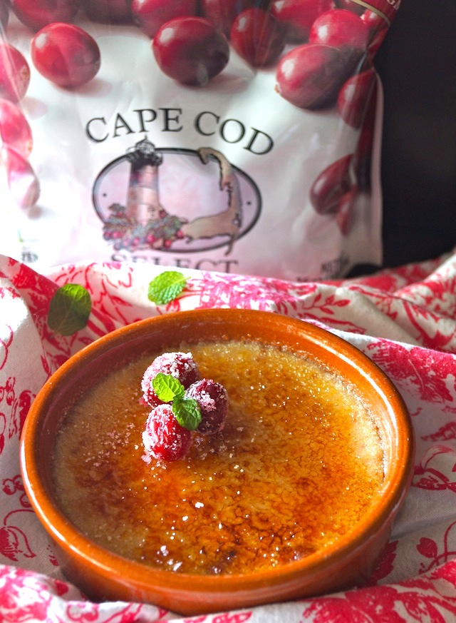 Cranberry Creme Brulee Recipe with Amaretto in a terracotta ramekin with bag of Cape Cod cranberries in background