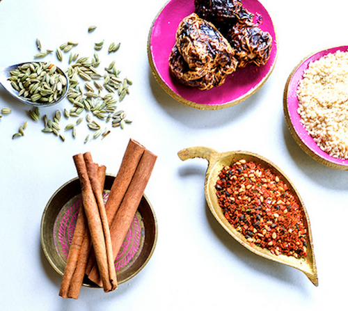 Raw Spice Bar spices in hot pink and gold bowls