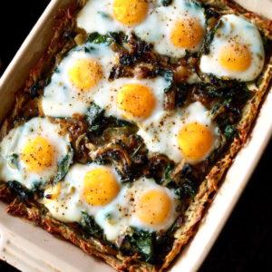 Baked Potato Crusted Prosciutto Eggs Florentine in rectangular pan.