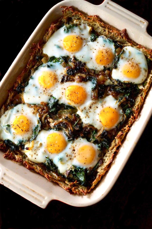 Baked Potato Crusted Prosciutto Eggs Florentine in rectangular pan.