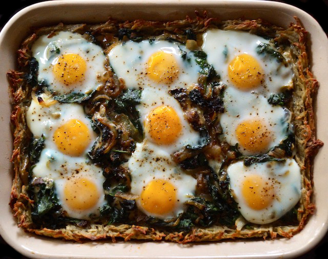 Baked Potato Crusted Prosciutto Eggs Florentine right out of oven in pan.