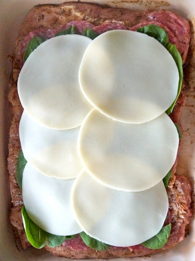 salami, spinach and provolone in layers on top of butterflied pork loin