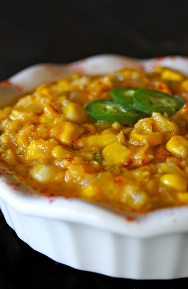 Vegan Jalapeno Creamed Corn in a white pie dish