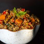 a cream colored bowl of Smoky Lemon Vegetable Quinoa