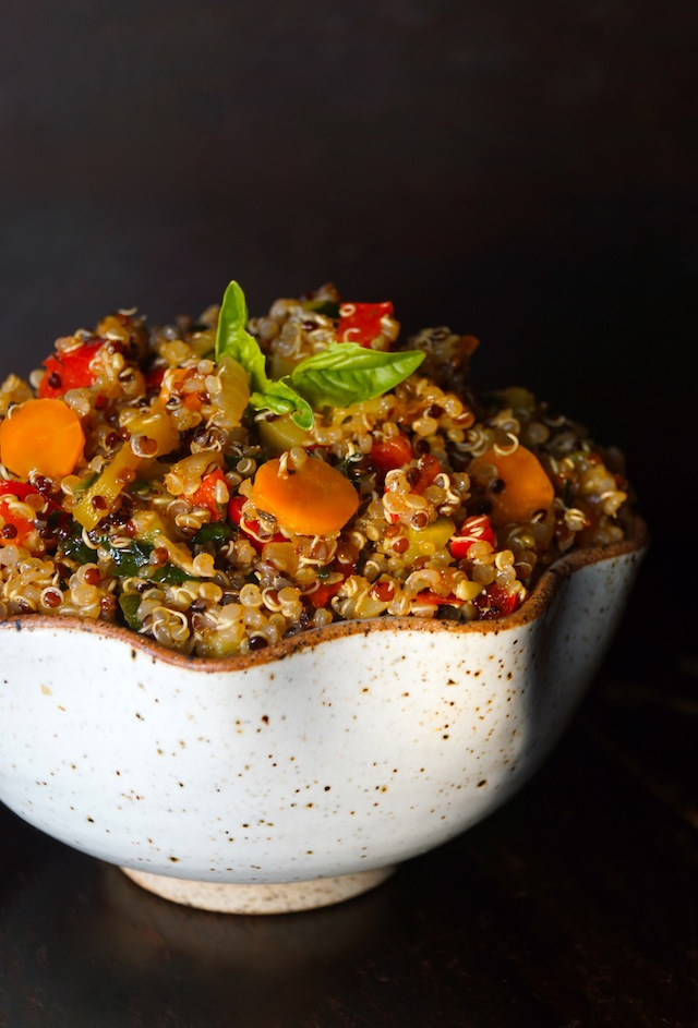 Vegetable Lemon Quinoa Recipe, with bright orange carrot round, red peppers and absil leaves on top