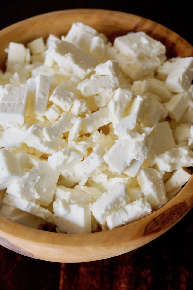 wooden bowl filled with chunks of Feta cheese for Greek-Style Lamb Lasagna Recipe